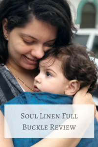 Mother carrying her baby in a Soul Linen Full buckle